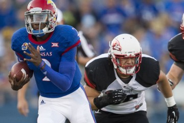 September 6, 2014 - Lawrence, KS, USA - Kansas Jayhawks quarterback Montell Cozart (2) picks up some yards after shaking Southeast Missouri State Redhawks safety Eriq Moore (36) in the first quarter during the University of Kansas and Southeast Missouri State football game at Memorial Stadium on Saturday, September 6, 2014, in Lawrence, Kan