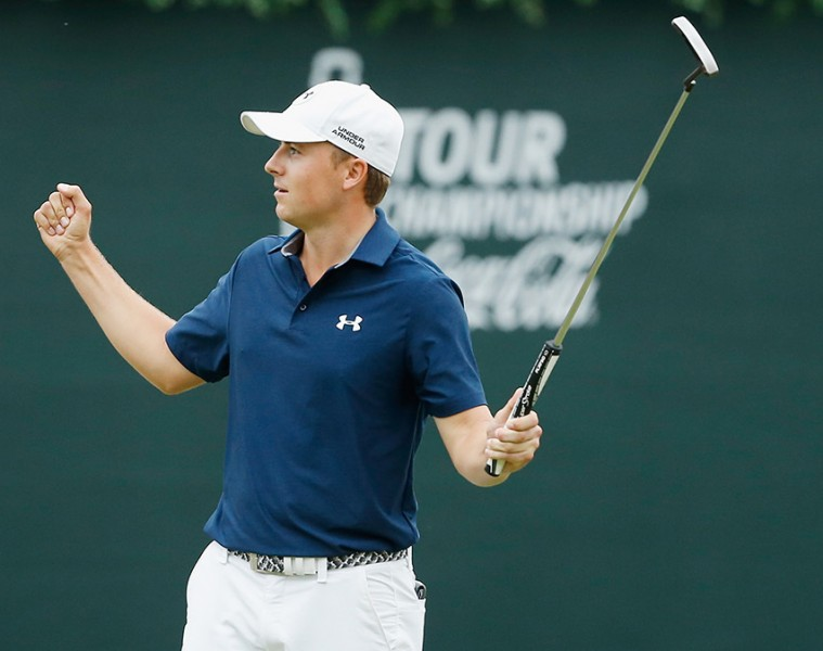 ATLANTA, GA - SEPTEMBER 27:  Jordan Spieth of the United States celebrates on the 18th green after his four-stroke victory at the TOUR Championship By Coca-Cola on his way to also securing the FedExCup at East Lake Golf Club on September 27, 2015 in Atlanta, Georgia  (Photo by Scott Halleran/Getty Images)