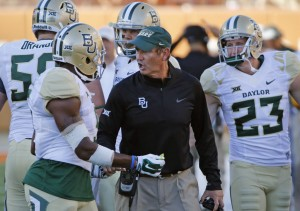 Baylor head coach Art Briles with his team during last year's game against Texas (Louis DeLuca - The Dallas Morning News)