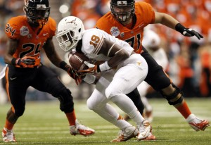 Linebacker Peter Jinkens (19) intercepts a pass. (Vernon Bryant - The Dallas Morning News)