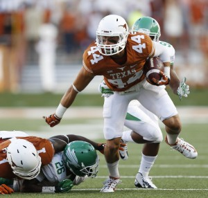 Defensive back Dylan Haines (44) runs after making an interception (Vernon Bryant - The Dallas Morning News)